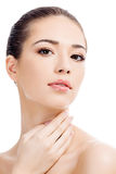 Beautiful girl with clean fresh skin. White background, copyspace royalty free stock image