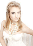 Beautiful girl with clean skin. Pearl necklace Stock Image