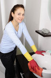 Beautiful girl cleaning the house Royalty Free Stock Photo
