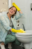 Beautiful girl cleaning up her house Stock Photos