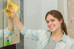Beautiful girl cleaning up her house Royalty Free Stock Photography