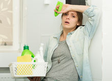 Beautiful girl cleaning up her house Stock Photography