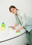 Beautiful girl cleaning up her house Royalty Free Stock Photo