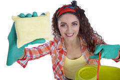 Beautiful girl cleans Royalty Free Stock Image