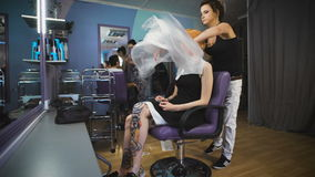 Beautiful girl in the client's chair beauty salon. stock video footage