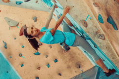 Beautiful girl climbing in gym Stock Photography