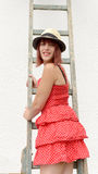 Beautiful girl climbing on a ladder Royalty Free Stock Photos