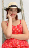 Beautiful girl climbing on a ladder Stock Images