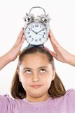 Beautiful girl with clock Royalty Free Stock Photo