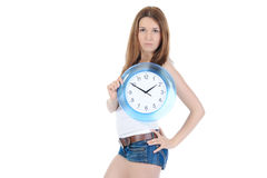 Beautiful girl with a clock in his hand Stock Photography
