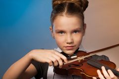 Beautiful girl close-up view playing on the violin Stock Photography