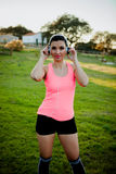 Beautiful girl in clothes for running with headphones royalty free stock images