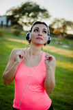 Beautiful girl in clothes for running with headphones stock images