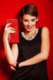Beautiful girl with a  clutch bag Royalty Free Stock Photography