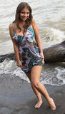 The beautiful girl on a coast. Of the river Royalty Free Stock Photos
