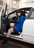 Beautiful girl in   coat in  car Stock Photography