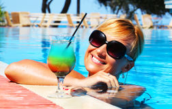 Beautiful girl and cocktail. Beautiful girl posing on swimming pool Stock Images