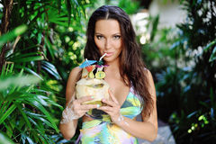 Beautiful girl with coconut cocktail Stock Photo