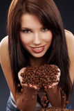Beautiful girl with coffee beans Royalty Free Stock Images