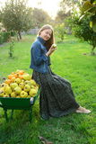 Beautiful girl collecting fresh fruit Stock Image
