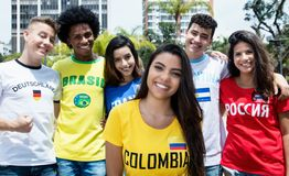 Beautiful girl from Colombia with sports fans from other countries. On the way to stadium stock photography
