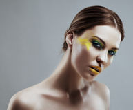 Beautiful girl with a color make-up Stock Photo