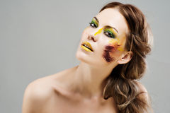 Beautiful girl with a color make-up Royalty Free Stock Photos