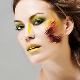 Beautiful girl with a color make-up Stock Photography