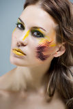 Beautiful girl with a color make-up Royalty Free Stock Image