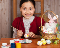 Beautiful girl colored Easter eggs Royalty Free Stock Images