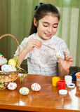 Beautiful girl colored Easter eggs Royalty Free Stock Photos