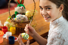 Beautiful girl colored Easter eggs Royalty Free Stock Photography