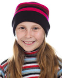 Beautiful girl in colored striped hat and sweater Royalty Free Stock Photo