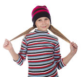 Beautiful girl in colored striped hat and sweater Royalty Free Stock Photos