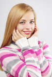 Beautiful girl in colored sweater Royalty Free Stock Photos