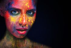 Beauty model with colorful powder make up royalty free stock photo