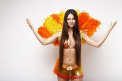 Beautiful girl in a colorful carnival costume.  white background. long hair. Girl with long hair in bright suit. carnival outfit. Brazilian carnival.  white Royalty Free Stock Photos
