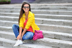 Beautiful girl in colorful clothes wearing sunglasses Royalty Free Stock Images