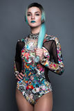 Beautiful girl in colorful dress with avant-garde hairstyles. Beauty the face. Stock Photos