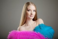 Beautiful girl with colorful feathers Stock Image
