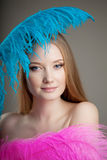 Beautiful girl with colorful feathers Royalty Free Stock Images