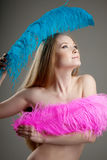 Beautiful girl with colorful feathers Royalty Free Stock Photo
