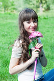 Beautiful girl with colorful flowers Stock Photo