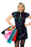 Beautiful girl with colorful packages. Royalty Free Stock Image