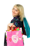 Beautiful girl with colorful packages. Stock Photos