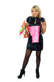 Beautiful girl with colorful packages. Royalty Free Stock Images