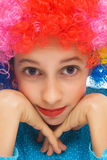 Beautiful girl with colorful party wig Stock Photos
