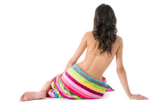 Beautiful girl with coloured beach towel Royalty Free Stock Photo