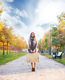 Beautiful girl with coloured hair holding a suitcase Stock Images