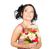 Beautiful girl with colourful bunch of flowers Stock Images